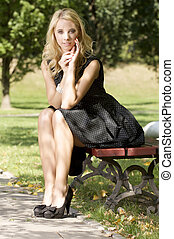 blond wonam in the garden - beautiful blond sensuality woman...