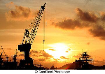 cranes in a harbor