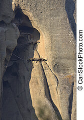 Ruins of an old extreme cavernous Monks shelter build up in a rock at  Meteora in Greece.