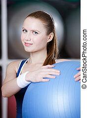 Woman with gym ball