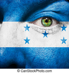 Flag painted on face with green eye to show Honduras support