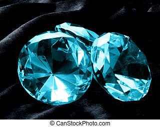Aquamarine Jewels - A close up on Aquamarine jewels on a...
