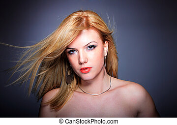 Glamor portrait over gray background