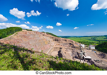 Big quarry under the blue sky