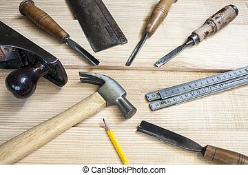 joiner tools,hammer chisel and meter on wood table...