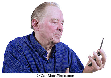 Elderly man figuring out how to use cell phone