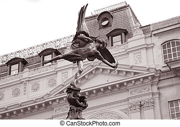 Statue of Eros by Gilbert (1895), Piccadilly Circus, London, England, UK in Black and White Sepia Tone