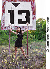 Thirteen river sign - Young woman near sign thirteen