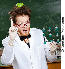 Mad scientist with an apple on his head shows forefinger while handing molecular model