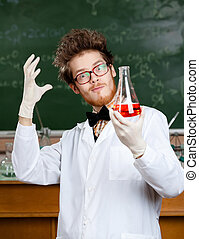 Mad professor admires his experimental red liquid - Mad...