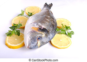 raw sea fish with lemon slices and parsley