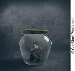Be ermetic concpet with a businessman closed in a jar