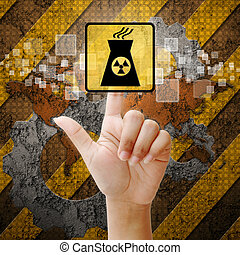 Hand press touch Nuclear power symbol on industry background