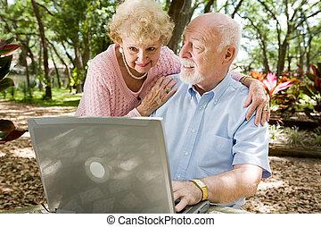 Seniors Surfing the Internet - Senior couple enjoying the...