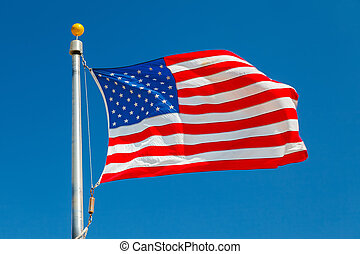 US Flag over blue sky