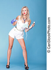 Sexual woman in nurse suit with stethoscope blue