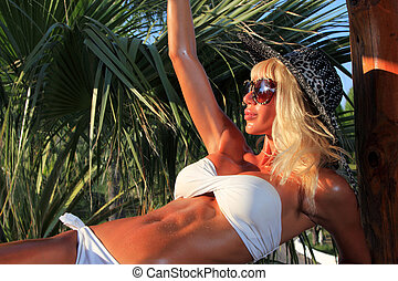 Young and sexy bikini model in tropical environment - Young...