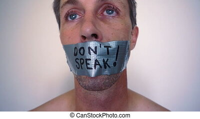 Speak No Evil Duct Tape - Close up head shot of a man with...