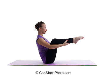 woman sit in yoga asana on rubber mat isolated - young woman...