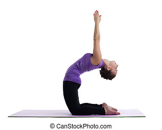 woman yoga instructor posing on rubber mat - woman as yoga...