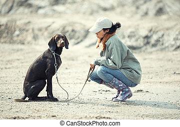 perro, domador