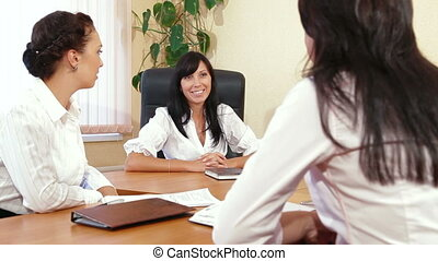 Working Team at Meeting - Three Business Women are...