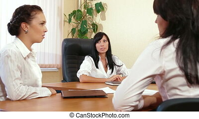 Business Team Discussing in Meeting - Business Women are...