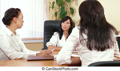 Business Women are Discussing - Three Business Women are...