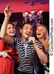 Singing friends - Portrait of happy people singing in...