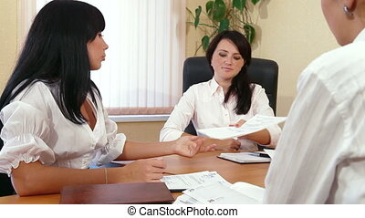 Business People in Meeting - Young Women Discussing Business...