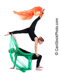two woman gymnast posing with flying fabric