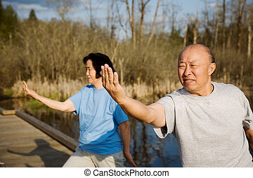 Senior exercise - A shot of a senior asian couple practicing...