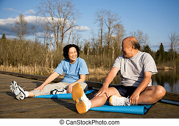 Senior couple exercise - A shot of a senior asian couple...