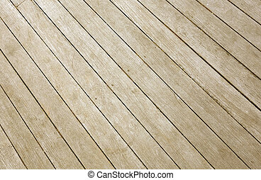 Weathered wooden decking planks close up.
