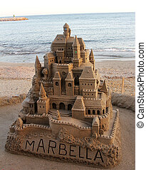 large sandcastle in spain - large sandcastle on the beach in...