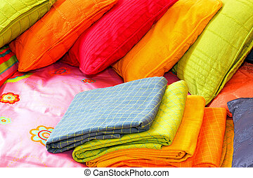 Colorful bedding - Bunch of colorful pillows and blankets...