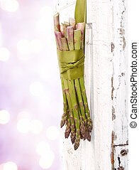 Bunch of asparagus hanging on a door - Bunch of asparagus...