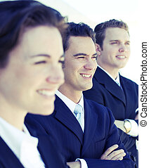 Business team - three business people standing in a row with...