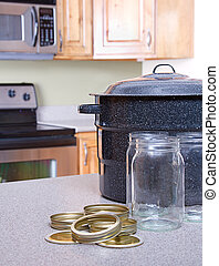 Canning jars and supplies in a kitchen - Canning jars with...