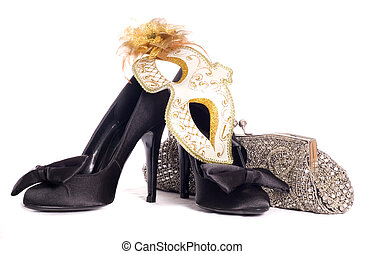 masquerade mask with high heel shoes and handbag studio...