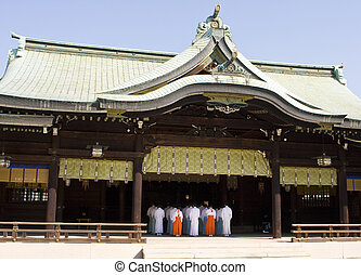 Shinto Temple With Priests - A traditional Shinto temple in...