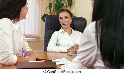 Casual Business Meeting - Three Young Women Discussing...