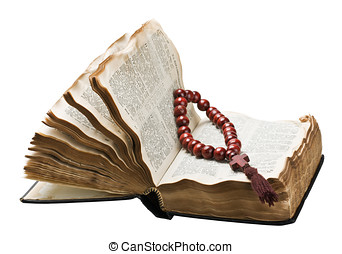 open bible and wooden rosary isolated on white background