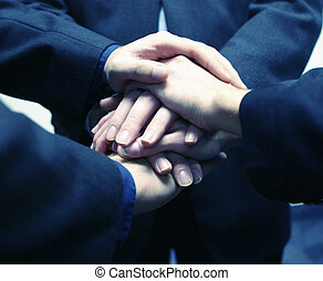 Business hands - close-up of three businessmens hands on top...