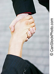 handshake - close up of handshake between two businessmen