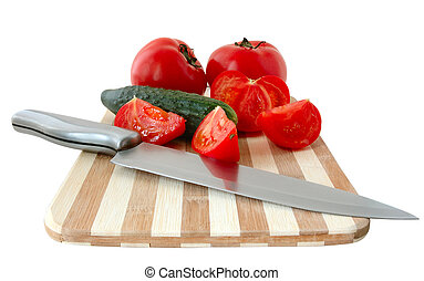 Vegetables on cutting board - Vegetables tomatos and...