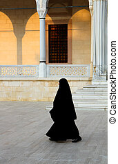 Religious Muslim woman walking - This Religious Muslim woman...