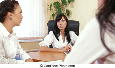 Office Meeting - Business Women Discussing In A Meeting