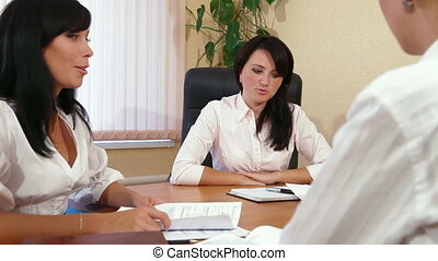 Businesspeople on Meeting - Three Young Women Discussing...