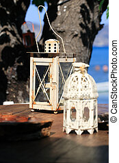 Old lantern with sea background